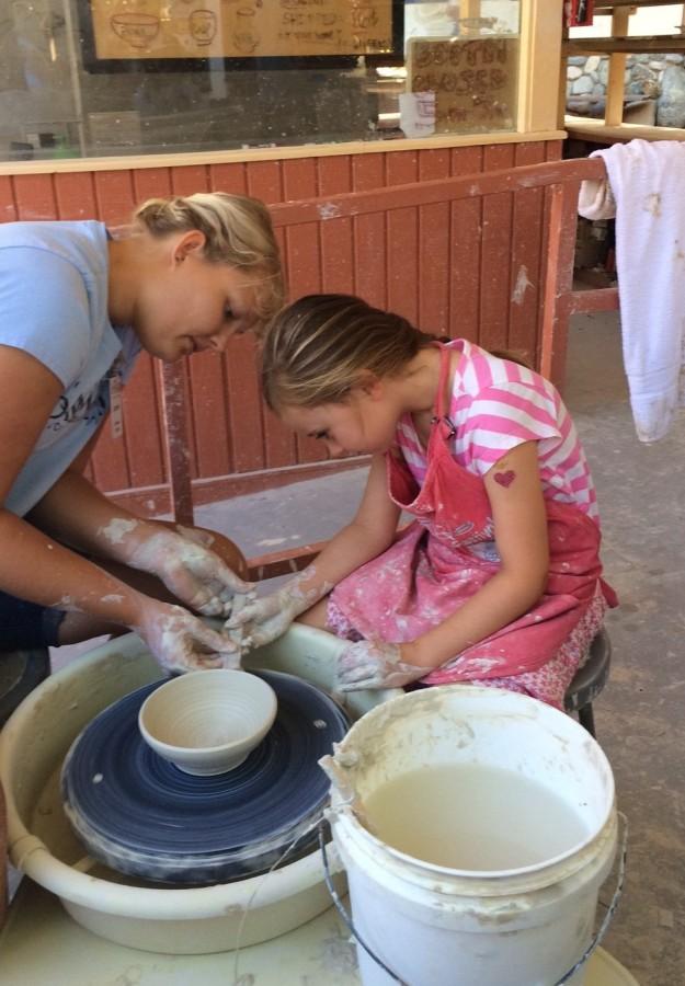 Sawdust Festival throwing a pot